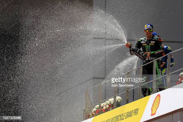 Johann Zarco of Monster Yamaha Tech 3 celebrate on the podium after winning the MotoGP race of the Malaysian Motorcycle Grand Prix held at Sepang...
