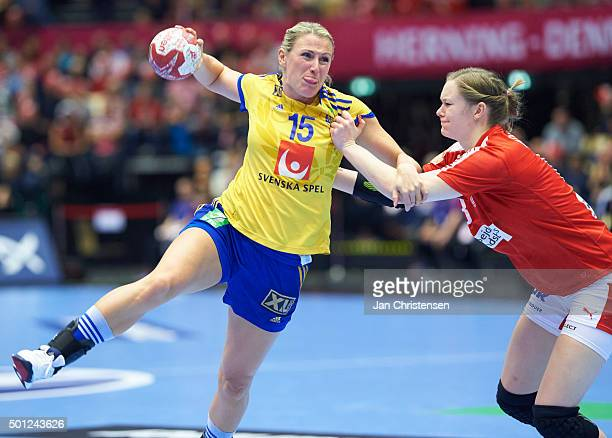 Johanna Ahlm of Sweden and Anne Mette Hansen of Denmark challenge for the ball during the 22nd IHF Women's Handball World Championship Eight Final...