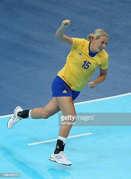 Johanna Ahlm of Sweden celebrates scoring a goal in the Women's Handball preliminaries Group B Match 4 between Denmark and Sweden on Day 1 of the...