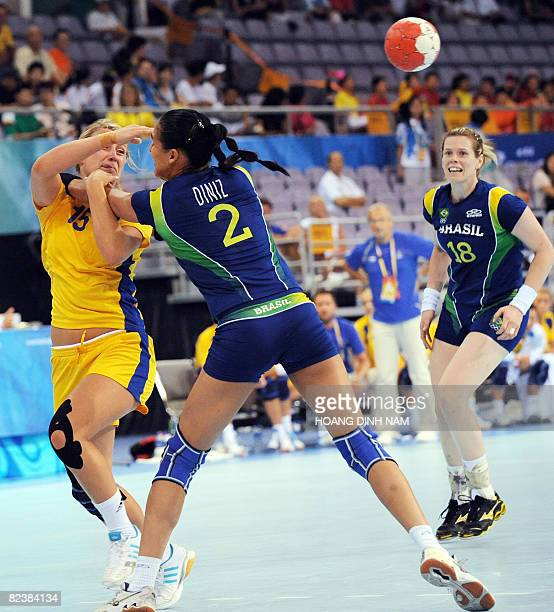 Johanna Ahlm of Sweden is challenged by Fabiana Diniz of Brazil as Brazil's Deonise Cavaleiro looks on in their Beijing 2008 Olympic Games...