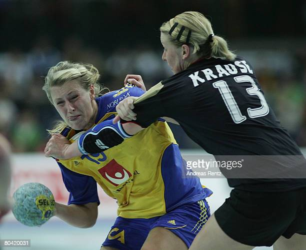Johanna Ahlm of Sweden is challenged by Nadine Krause of Germany during the women's handball Olympic qualification tournament match between Germany...