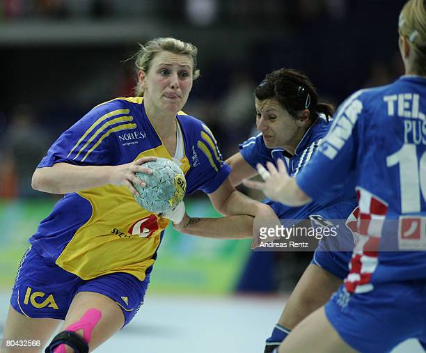 Johanna Ahlm of Sweden is challenged by Petra Starcek of Croatia during the women's handball Olympic qualification tournament match between Sweden...