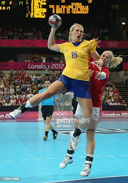 Johanna Ahlm of Sweden shoots and scores a goal in the Women's Handball preliminaries Group B Match 4 between Denmark and Sweden on Day 1 of the...