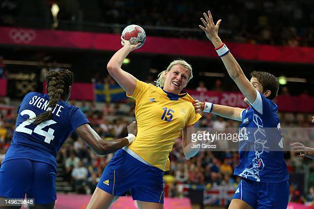 Johanna Ahlm of Sweden throws for goal in their Women's Handball Preliminaries Group B match against France on Day 5 of the London 2012 Olympic Games...
