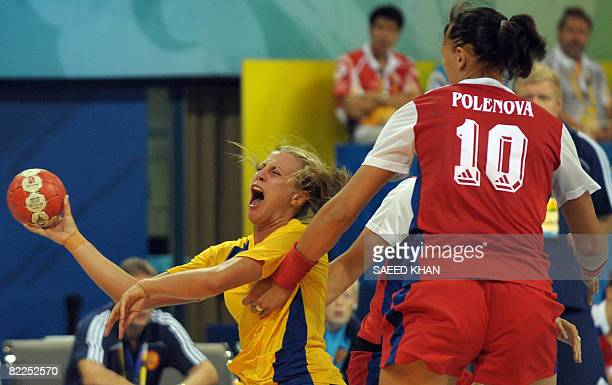 Johanna Ahlm of Sweden vies with Elena Polenova of Russia during their 2008 Olympics Games women's Handball match on August 11 in Beijing AFP PHOTO /...