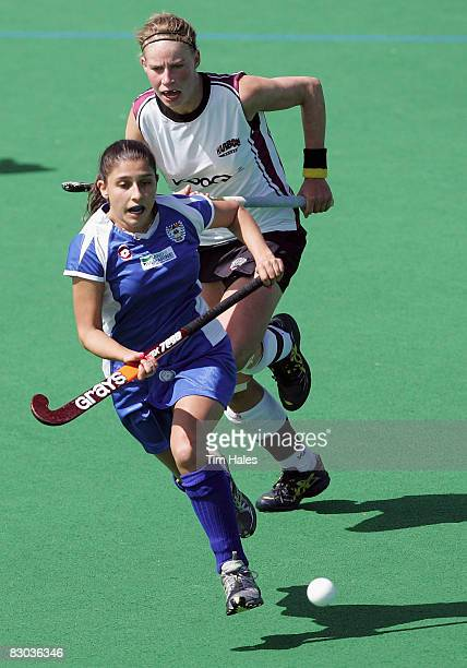 Johanna Bilkey of Auckland runs away from AnneSophie Van Regemortal during the women`s final of the National Hockey League between Auckland and North...