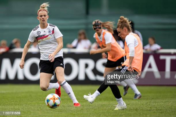 Johanna Elsig and Linda Dallmann of Germany battle for possession during a training session of the German women's national football team on June 04...