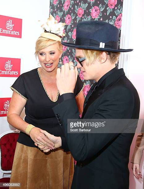 Johanna Griggs talks to Cody Simpson at the Emirates Marquee on Stakes Day at Flemington Racecourse on November 7 2015 in Melbourne Australia