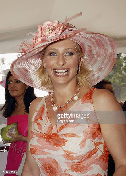 Johanna Griggs Wearing a dress by Jane Camortonand a hat by Neil Grigg during Crown Oaks Day at Flemington Racecourse November 4 2004 in Melbourne...