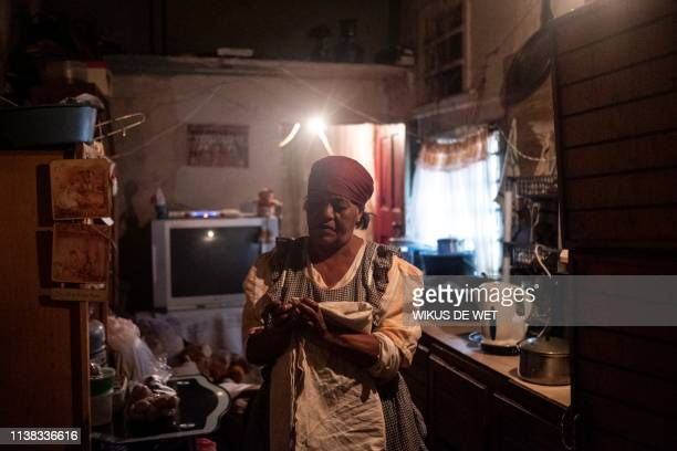 Johanna Harrison stands inside her house on April 5 2019 in Kliptown near Soweto South Africa goes to the polls next month the country's sixth since...