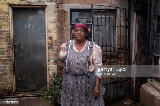 Johanna Harrison stands outside her house on April 5 2019 in Kliptown near Soweto South Africa goes to the polls next month the country's sixth since...