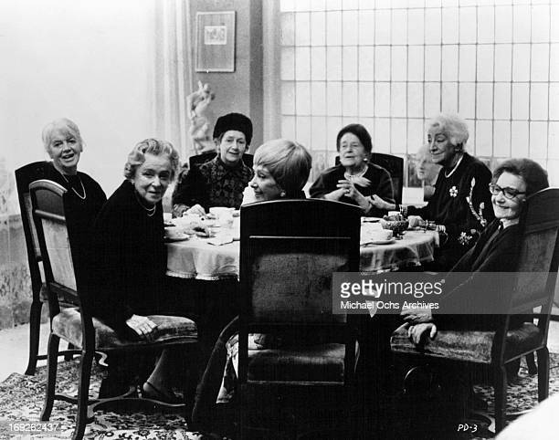 Johanna Hofer Kathe Haack Peggy Ashcroft Lil Dagover and Elisabeth Bergner sit at a table in a scene from the film 'The Pedestrian' 1973