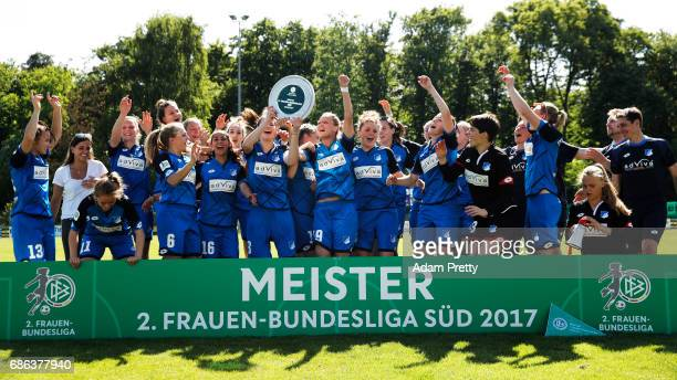 Johanna Kaiser of Hoffenheim II and her team mates celebrating with the 2 Bundesliga Womens trophy after victory in the match between 1899 Hoffenheim...