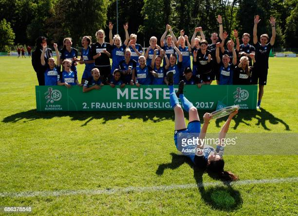 Johanna Kaiser of Hoffenheim II and her team mates celebratw with the 2 Bundesliga Womens trophy after victory in the match between 1899 Hoffenheim...