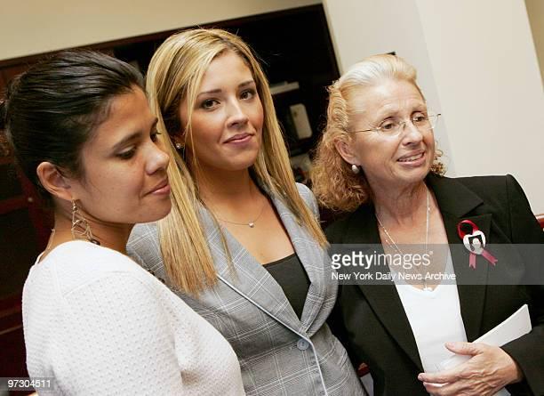 Johanna King Vespe a classmate of slain graduate student Imette St Guillen stands with Imette's mother Maureen and sister Alejandra during a news...