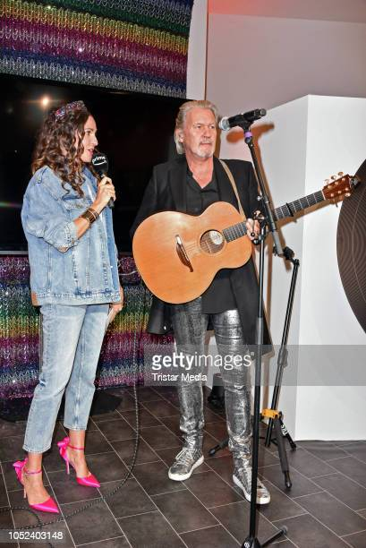 Johanna Klum and Johnny Logan attend the Deutschland86 PopUpStore Opening on October 17 2018 in Berlin Germany