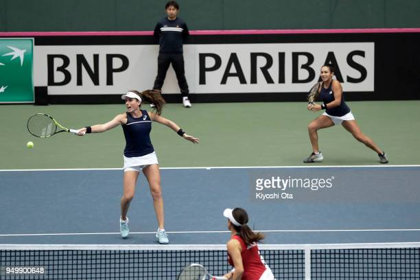 Johanna Konta and Heather Watson of Great Britain play in their doubles match against Miyu Kato and Makoto Ninomiya of Japan during day two of the...