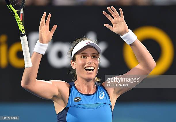 Johanna Konta of Britain celebrates the winning point against Agnieszka Radwanska of Poland in the women's singles final match at the Sydney...