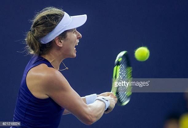 Johanna Konta of Britain hits a return against Elina Svitolina of Ukraine during their women's singles semifinal match at the WTA Elite Trophy tennis...