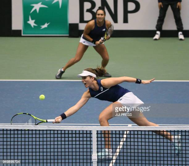 Johanna Konta of Britain hits a return in front of teammate Heather Watson during their Fed Cup World Group II playoff women's doubles tennis match...