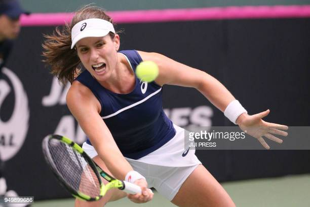 Johanna Konta of Britain hits a return to Naomi Osaka of Japan during their Fed Cup World Group II playoff women's singles tennis match in Miki Hyogo...