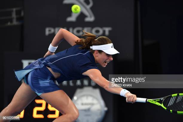 Johanna Konta of Germany hits a return against Elina Svitolina of Ukraine during their women's singles quarterfinal match at the Brisbane...