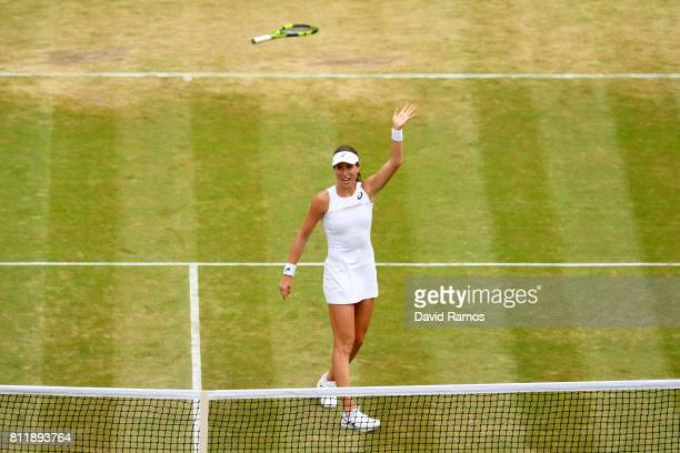 Johanna Konta of Great Britain acknowledges the crowd as she celebrates victory after the Ladies Singles fourth round match against Caroline Garcia...
