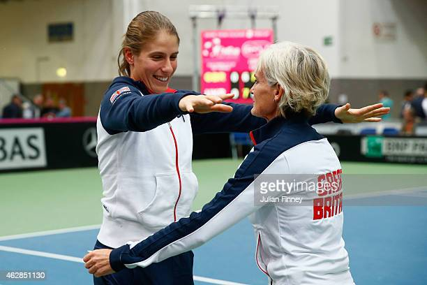 Johanna Konta of Great Britain and Captain Judy Murray celebrate together after they advance to the next match during day three of the Fed Cup/Africa...
