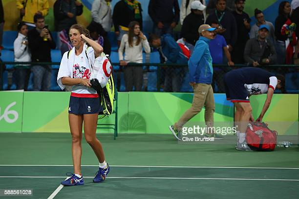 Johanna Konta of Great Britain and Jamie Murray of Great Britain leave the court after defeat in the mixed doubles first round match against Bethanie...