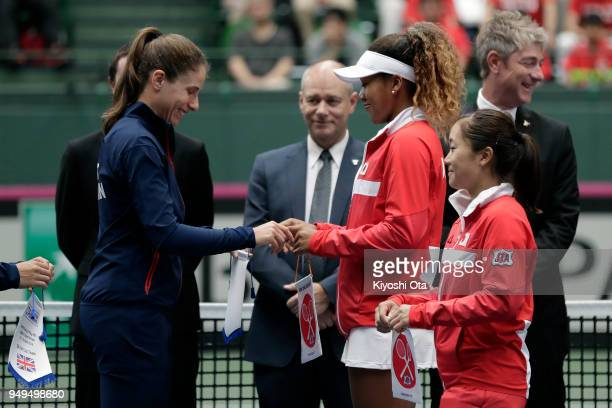 Johanna Konta of Great Britain and Naomi Osaka of Japan exchange pennants at the opening ceremony during day one of the Fed Cup World Group II...