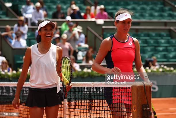 Johanna Konta of Great Britain and SuWei Hsieh of Taipei walk off court following the first round match on day three of the 2017 French Open at...