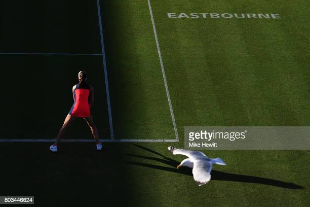 Johanna Konta of Great Britain awaits a serve during the ladies singles quarter final match against Angelique Kerber of Germany on day five of the...