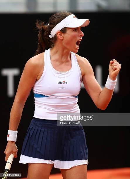 Johanna Konta of Great Britain celebrates against Marketa Vondrousova of Czech Republic in their Women's Single Quarterfinal Match during Day Six of...
