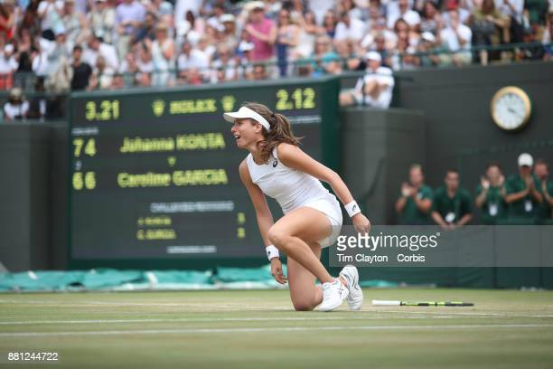 Johanna Konta of Great Britain celebrates her victory against Caroline Garcia of France in the Ladies' Singles round of 16 on NO1 Court during the...