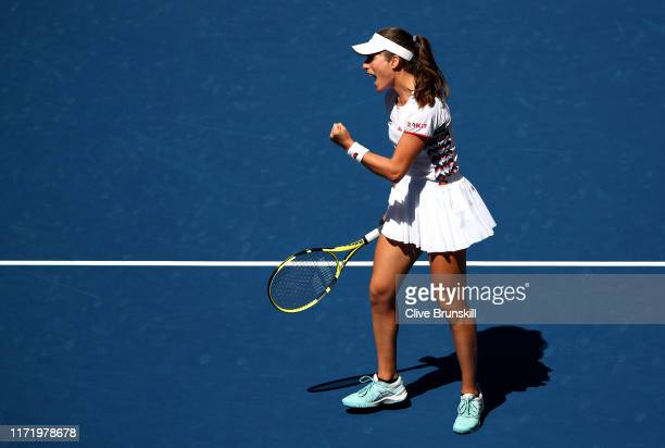 Johanna Konta of Great Britain celebrates in her Women's Singles quarterfinal match against Elina Svitolina of the of the Ukraine on day nine of the...