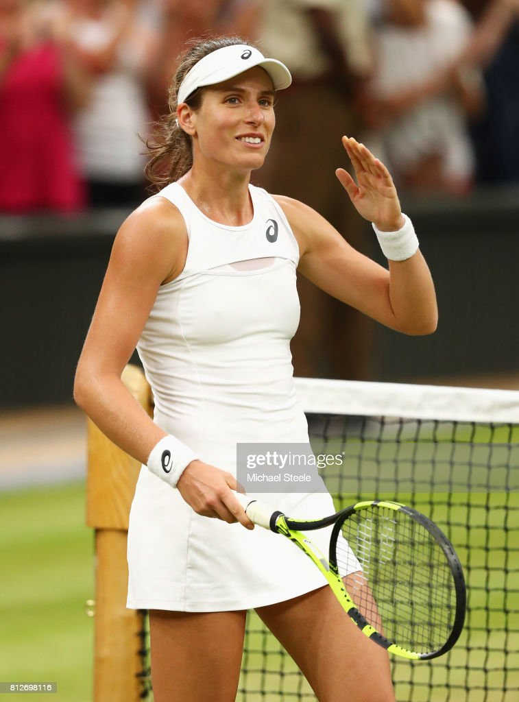 Johanna Konta of Great Britain celebrates victory after the Ladies Singles quarter final match against Simona Halep of Romania on day eight of the Wimbledon Lawn Tennis Championships at the All England Lawn Tennis and Croquet Club on July 11, 2017 in London, England.