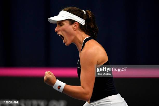 Johanna Konta of Great Britain celebrates winning the second set during her Europe/Africa Group A match against Maria Sakkari of Greece on Day Two of...
