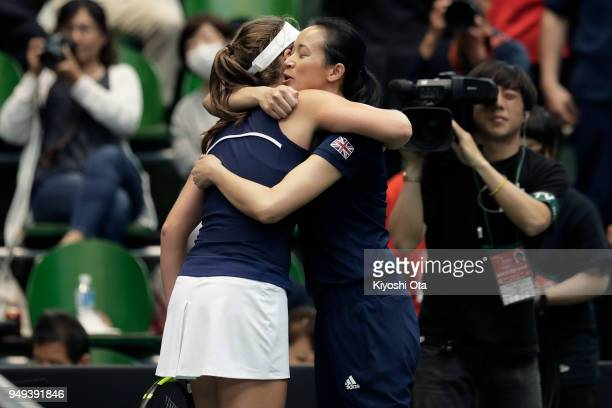 Johanna Konta of Great Britain celebrates with team captain Anne Keothavong of Great Britain after winning her singles match against Kurumi Nara of...