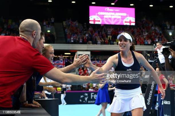 Johanna Konta of Great Britain celebrates with team mates and staff after winning her second singles match against Kazakhstan's Yulia Putintseva...