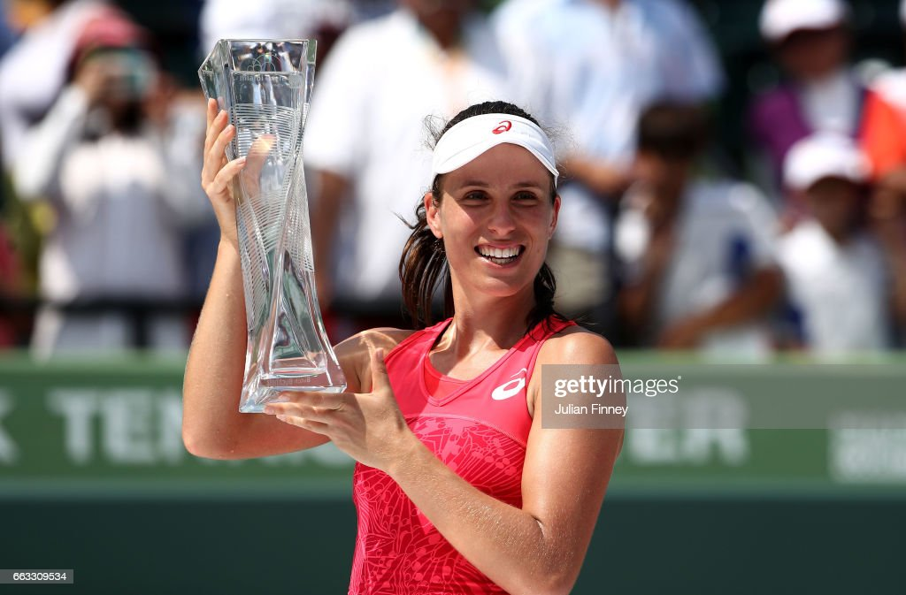 Johanna Konta of Great Britain celebrates with the Butch Buchholz trophy after winning the women's singles final match against Caroline Wozniacki of Denmark on day thirteen of the 2017 Miami Open at Crandon Park Tennis Center on April 1, 2017 in Key Biscayne, Florida.