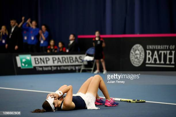 Johanna Konta of Great Britain collapses as she wins her promtional playoff match against Aleksandra Krunic of Serbia on day four of the Fed Cup...