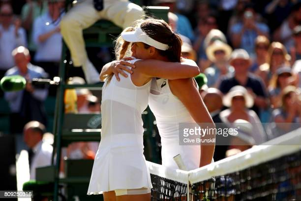 Johanna Konta of Great Britain consoles an emotional Donna Vekic of Croatia after their Ladies Singles second round match on day three of the...