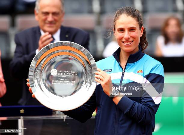 Johanna Konta of Great Britain holds her runners up trophy after her straight sets defeat against Karolina Pliskova of the Czech Republic in the...