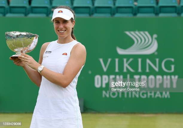 Johanna Konta of Great Britain holds the Viking Open Trophy after she beat Shuai Zhang of China in the women's singles final at Nottingham Tennis...