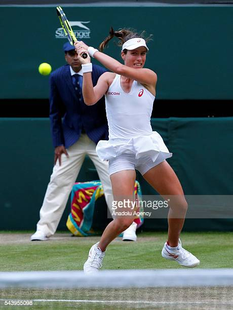 Johanna Konta of Great Britain in action against Eugenie Bouchard of Canada in the women's singles on day four of the 2016 Wimbledon Championships at...