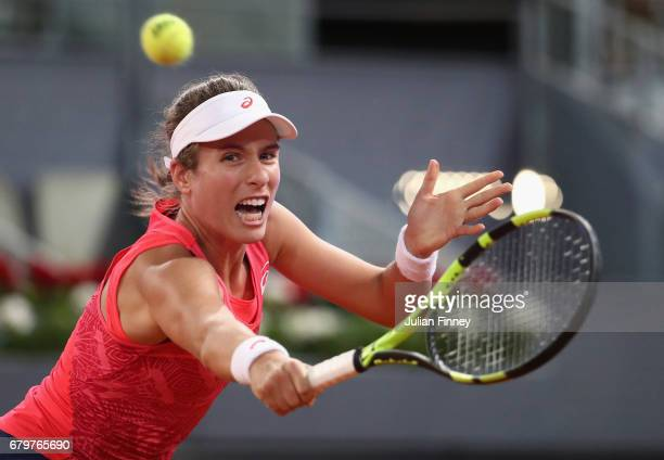 Johanna Konta of Great Britain in action against Laura Siegemund of Germany during day one of the Mutua Madrid Open tennis at La Caja Magica on May 6...