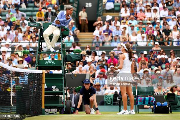 Johanna Konta of Great Britain in discussion with umpire Marija Cicak during the Ladies Singles fourth round match against Caroline Garcia of France...