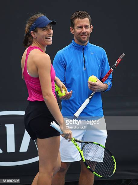 Johanna Konta of Great Britain in good spirits with her coach Wim Fissette during her first practice session ahead of the 2017 Australian Open at...