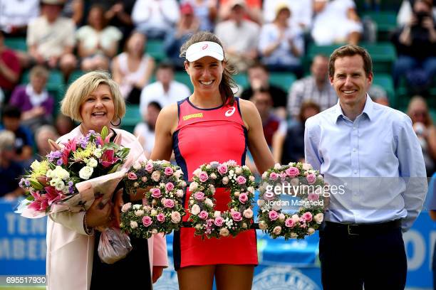 Johanna Konta of Great Britain is presented with a wreath to commemorate her 300th singles career win from WTA Tournament Director for Aegon Open...