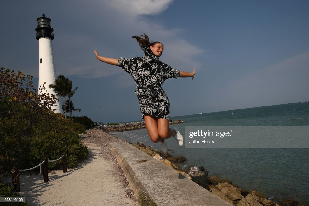 Johanna Konta of Great Britain jumps in the air next to a lighthouse during a photo shoot after she defeated Caroline Wozniacki of Denmark in the final at Cape Florida on April 1, 2017 in Key Biscayne, Florida.
